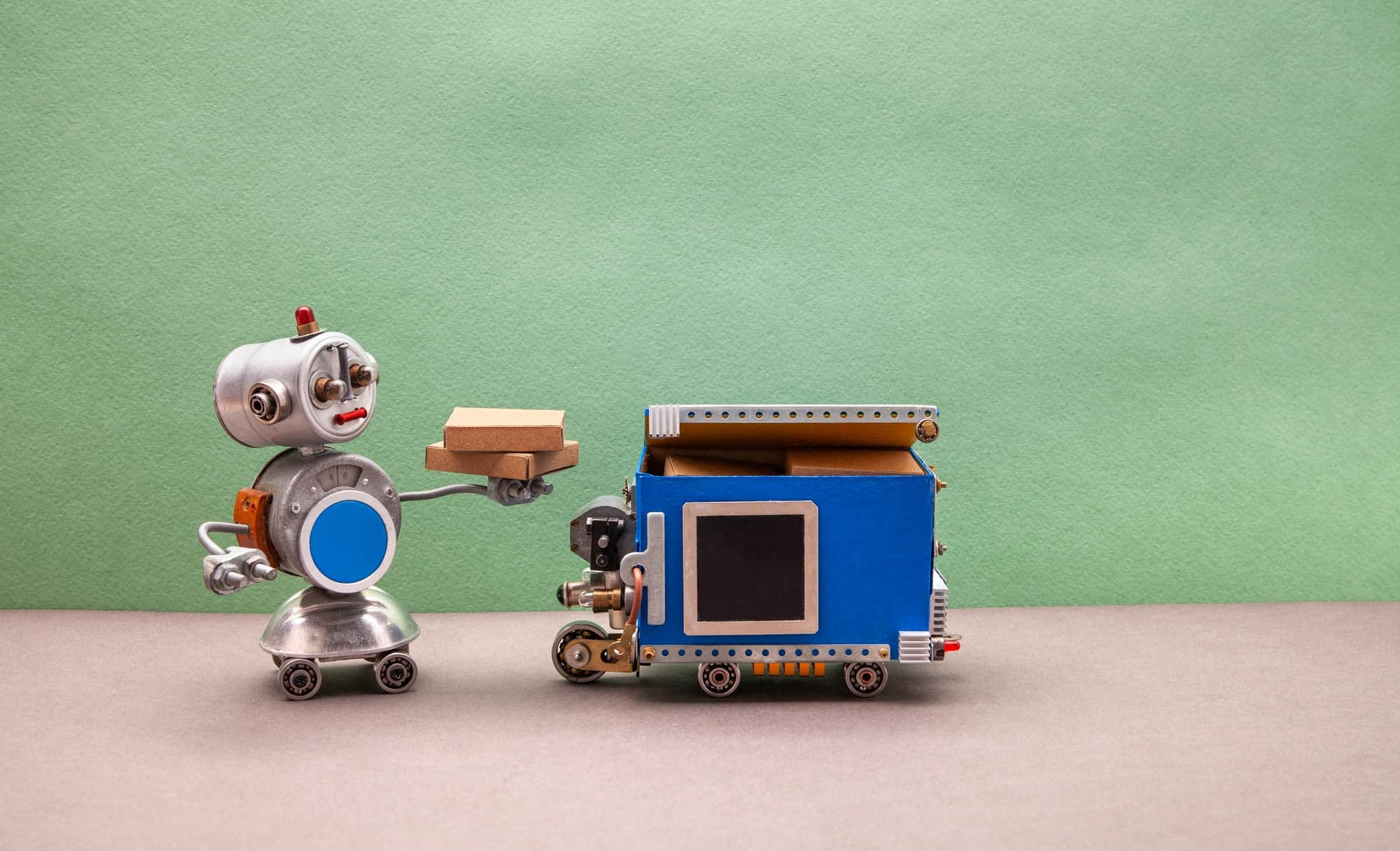 Delivery business concept. Robot toy with parcel boxes